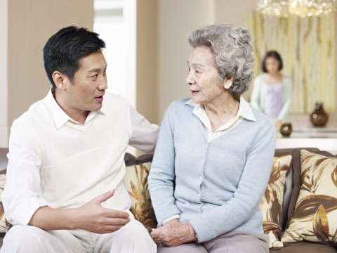man-talking-elderly-mother